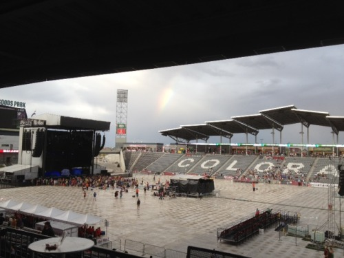 Rainbow over field before show