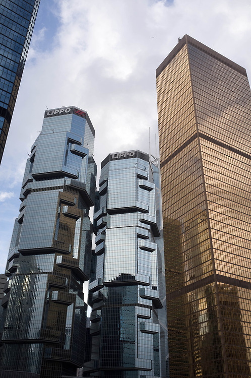 "houseofhegira:  The Lippo Center twin towers in Hong Kong are affectionately known as ""The Koala Tree"" because of their resemblance to the animals clutching to a tree. The buildings rise to 186m and were completed in 1988."
