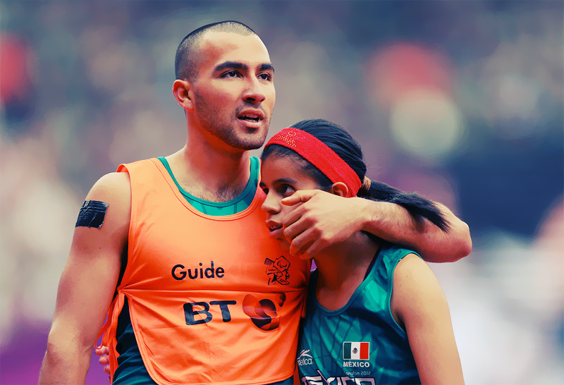 Blind runner Daniela Eugenia Velasco Maldonado of Mexico with her guide Jose Guadalupe Fuentes Ortiz after running the Women's 400m - T12 heats Photo by Mike Ehrmann