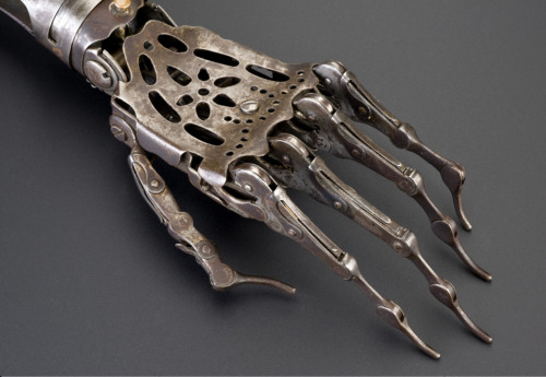 "collective-history:  Artificial left arm, Europe, 1850-1910 ""Made from steel and brass, the elbow joint on this artificial arm can be moved by releasing a spring, the top joint of the wrist rotates and moves up & down, and the fingers can curl up and straighten out. The wearer may have disguised it with a glove. Among the most common causes of amputation throughout the 1800s were injuries received as a result of warfare."" Science Museum"