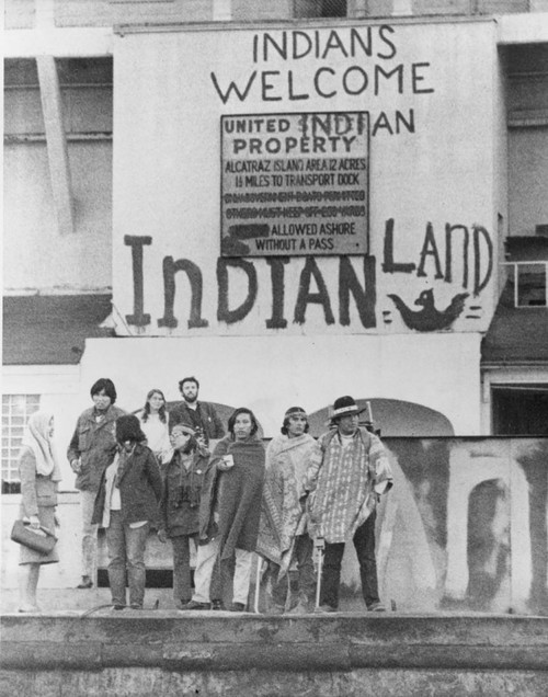 "doveilmiosoldi:  this was tagged ""indian reservation."" INDIAN RESERVATION. i'm taking this as a sign that some basic education is in order: reservations were created to corral Natives onto ever-shrinking allocations of land, which may or may not have been based on respective ancestral lands. they are a symbol of the ongoing colonization of Native peoples. the process by which Natives were removed from their lands and pushed onto reservations was extremely violent—millions and millions of people died, and Native peoples live with the intergenerational trauma and legacies of the reservation system to this day.  this photo was not taken on a reservation. this photo was taken on Alcatraz Island, a small island in the Bay (between San Francisco and Oakland). the island was originally used by the US government as a detention center for Native prisoners of war (taken from places as far off as Arizona), and later was used as a detention center for men who had committed crimes during their service for the US military. Following this, the island was used as host to the infamous Alcatraz penitentiary, until it was shut down in 1963. according to federal law (Treaty of Fort Laramie), government-owned lands that are not being used or are otherwise abandoned become the legal property of Natives from which it was originally ""acquired."" citing this law, Indians of All Nations seized the island in 1969—this photo is from the subsequent Indian occupation of the island. an iconic moment in US, Native American, & Civil Rights histories, the occupation would last 19 months. Natives from all areas of the Americas gathered to live on the island, and built communities and homes there. following the occupation, the US government returned lands to the Taos, Yakama, Navajo, and Washoe tribes (returned thanks to demands made at Alcatraz, re: Treaty of Fort Laramie). Nixon also rescinded the Indian termination policy during the occupation, and instated the current self-determination policy.  this photo is representative of one of the most treasured moments in contemporary Native anti-colonial struggle. it's a true testament to the US colonial education system that the person who posted this was unaware of this event."
