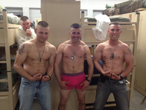 Three straight shirtless marine soldiers in the barracks - one in boxer briefs.