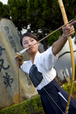 "Mizue Hasegawa practices the ancient art of kyudo at Soto Mission of Hawaii in Nuuanu. Hasegawa, president and sensei of local archery club Hawaii Kyudo Kai, says it's the oldest martial art in Japan, one with deep philosophical roots. ""We focus on three main goals: shin, the truth, zen, the goodness, and bi, the beauty,"" she explains. ""If you have all three, the arrow should go through the target. But hitting the target is not our main objective."" Hawaii Kyudo Kai's 15 members hone their skills every Sunday (via xandros-av:)"