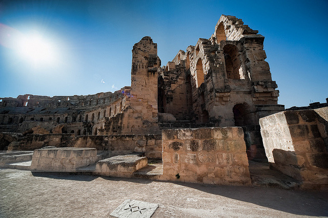 El Jem Amphitheatre on Flickr.*** from wiki *** El Djem is famous for its amphitheater, often incorrectly called a Colosseum (roughly translated from Latin as 'that thing by the Colossus'), which is capable of seating 35,000 spectators. Only the Flavian Amphitheater in Rome (about 45,000 spectators) and the ruined theatre of Capua are larger. The amphitheatre at El Djem was built by the Romans under proconsul Gordian, who was acclaimed Emperor at Thysdrus, around 238 and was probably mainly used for gladiator shows and chariot races (like in Ben-Hur). Many tourists come here to see what it was like to be inside what was once a place where lions and people met their fate. Much of it is crumbled but the essence of it still remains. It is also possible that construction of the amphitheatre was never finished. Until the 17th century it remained more or less whole. From then on its stones were used for building the nearby village of El Djem and transported to the Great Mosque in Kairouan, and at a tense moment during struggles with the Ottomans, the Turks used cannons to flush rebels out of the amphitheatre. The ruins of the amphitheatre were declared a World Heritage Site in 1979. Drifting sand is preserving the market city of Thysdrus and the refined suburban villas that once surrounded it. The amphiteatre occupies archaeologists' attention: no digging required. Some floor mosaics have been found and published, but field archaeology has scarcely been attempted. In the world of writing materials, Thysdrus lay in the Empire of Papyrus, which preserves remarkably well if kept as dry as at El Djem.. ******** The amphitheater was used for filming some of the scenes from the 1979 Monty Python film The Life of Brian and was also used for filming some of the scenes from the Academy Award (Oscar) winning film Gladiator with Russel Crowe. In the old days when it was used for real gladiators, the gladiators would be kept in dungeons under ground. The star shaped holes in front being their only lightsource. The construction seemed to be made up by 3 vertical sections connected by stairs and hallways. Truly a visit I will remember for long time… I got a few more from this place that I will show you later. Hope you all have a great week ahead!