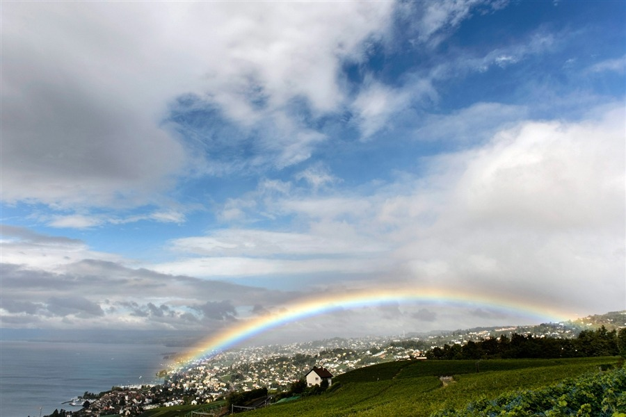 A rainbow appears over Lutry, Switzerland, and Lake Geneva, as seen from the Lavaux Vineyard, Sept. 1. The Lavaux Vineyard Terraces are on UNESCO's list of world cultural heritage sites. [Credit : Laurent Gillieron / EPA]