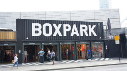 BOXPARK Shoreditch is a retail revolution – the world's first pop-up mall. Based in the heart of East London, for the next five years. BOXPARK strips and refits shipping containers to create unique, low cost, low risk, 'box shops'. Boxpark by Yukino Miyazawa on Flickr.