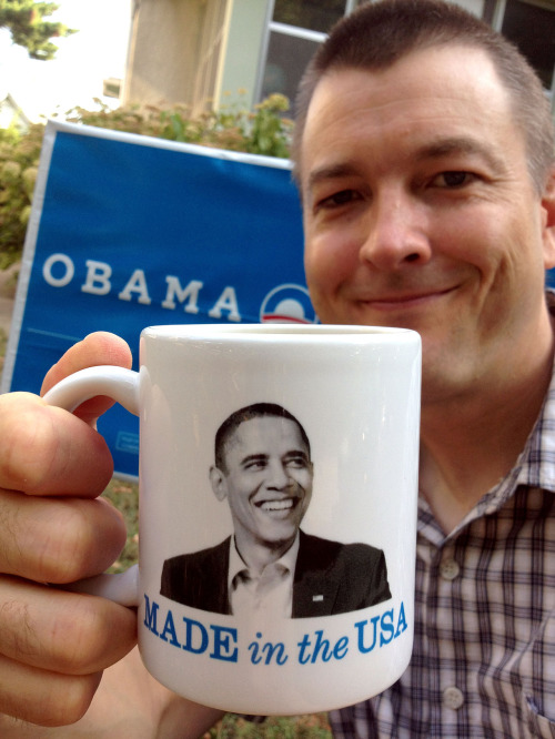 "Mugshot Monday - ""Barack Obama — Made in the USA"" coffee mug with Break Away Blend by Peace Coffee With the Democratic National Convention kicking off this week, I thought it was a good time to feature my Obama Made in the USA coffee mug. I'm sitting in front of my neighbor's house — she's already got her Obama/Biden sign out. It has the President's birth certificate printed on the other side, which is pretty cool. I like this mug because it makes a statement, rather than just state the Democratic ticket ""Obama Biden 2012"". It's a reaction to all the Barack Obama citizenship conspiracy theories. I did try to find a Mitt Romney coffee mug for the start of the Republican National Convention last week, but I couldn't find any good ones — any mugs that made a statement AND were awesome. But now I'm not sure if I will. (Read more about that here: ""Is making a Mitt Romney coffee mug disrespectful? "") By law, I think I'm supposed to give equal time to a political opponent, so let me know if you see a Mitt Romney coffee mug!"