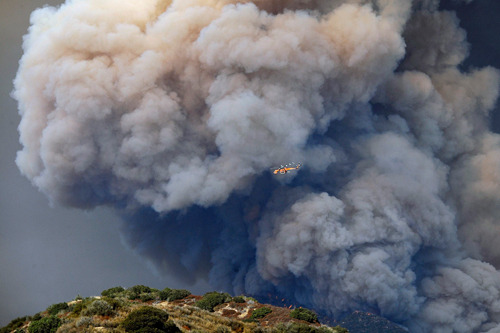 breakingnews:  California wildfire prompts evacuation of Angeles national forest AP: A wildfire that broke out in the Angeles national forest has cut short the Labor Day holiday weekend for thousands of visitors to the park. The fire broke out near a campground Sunday afternoon and quickly grew to 3,600 acres, or about five and a half square miles. It sent a huge cloud of smoke that could be seen from the coast to the desert inland. Photo: A sky crane helicopter flies past a plume of thick smoke rising from the hills above San Gabriel mountains in the Angeles National Forest, California. (REUTERS / Gene Blevins)