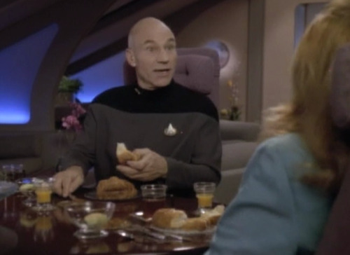 syfycity:  Can anyone identify Picard's uniform in this scene? I've never seen it before. http://syfycity.tumblr.com  It's just a more casual undershirt. It's usually seen when Picard is off duty. Their uniforms look heavy enough already so it's hard to image there being anything underneath besides underwear. The gray undershirt first appears in Season 5, Episode 2, Darmok; where Picard is stranded on the planet with Dathon. In that episode he pulls open the red jacket where we see the gray undershirt for the first time. But I think it's strictly a variant of Picard's uniform only. There's a few episodes late in the series where he can be seen walking around with the red jacket open, gray underneath. Source: I'm a nerd and obsessed with TNG.