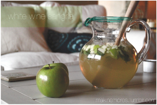 white wine sangria w. apple and mint … & my new apartment  i got back to dallas about a week ago and my apartment is finally starting to resemble a suitable living environment. most exciting find for me: a 3-piece coffee table set off craigslist from pottery barn - all white, wood, and exactly what i was looking for, mainly because it will look good in pictures and now that my roommate and i have a dining table, couch, AND coffee table, we find it necessary to entertain every night of the week. Friday night we opted for a refreshing  white sangria that pretty much tasted like spa in a glass — and, of course, the first recipe i am posting after getting my own kitchen is a drink that requires zero cooking but basically i was just in love with how the green and white drink looked in my green and white themed apartment (ignore the blue and white pillows in the background - they will be replace shortly) recipe courtesy of The Clever Carrot  Ingredients 1 bottle of dry white wine, such as sauvignon blanc 1 cup all natural lemonade 1/4 cup triple sec club soda 4 granny smith apples, thinly sliced 1 bunch of mint ice   Instructions In a large pitcher, combine white wine, lemonade and triple sec. Using a mandoline, thinly slice your apples and add them to the pitcher. The lemonade will help prevent them from turning brown. Also, depending on the size of your apples, you may not need to use all of them. It's up to you. If you are making this in advance, chill in the refrigerator. Right before serving, toss in some whole mint leaves and give it a stir. Fill individual glasses with ice. Pour in some sangria and top off with club soda. Garnish with extra apple slices and mint.