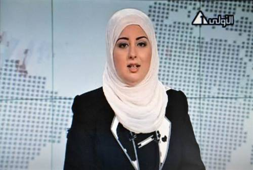 farhanist:  thepoliticalnotebook:  On Sunday, Fatma Nabil became the first female news presenter to appear on Egyptian state television wearing a head scarf. Under Mubarak's rule women could not take on-camera jobs while wearing Muslim head garb, and despite the fact that many sued and even won, the rulings were ignored. (Don't read this as any implicit support on my behalf for President Morsi, Egypt's Islamists or even for Egyptian state television… what I do very much support is the fact that women who wish to wear the headscarf while in pursuit of their own career are free to do so.) Screen grab of state TV via MSNBC.  Freedom.