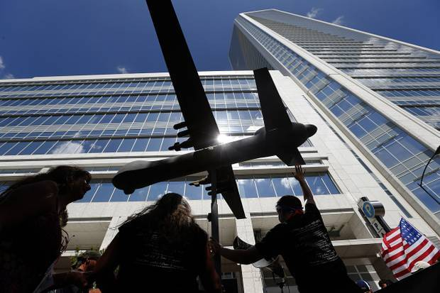 A model of a Reaper Drone is pushed past the Duke Energy building as activists marched in the Coalition to March on Wall Street South, a 3-mile march Sunday, September 2, 2012, to spotlight Charlotte as the United States' second-largest financial center, behind New York. Activists stopped in front of the headquarters of Bank of America and Duke Energy as they took to the streets in downtown Charlotte, site of the 2012 Democratic National Convention.