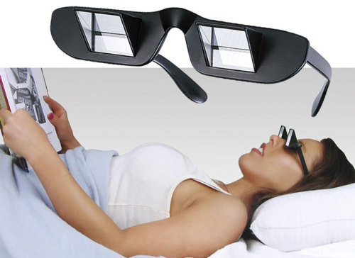 laughingsquid:  Prism Glasses Enable Reading While Lying Down  I want!