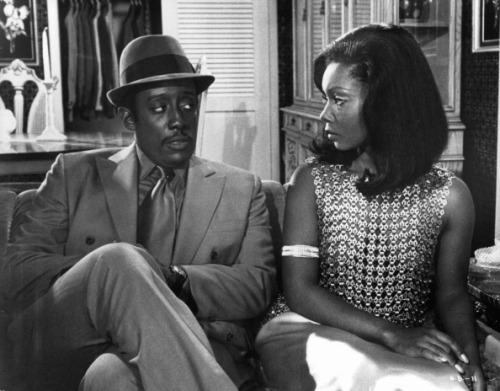 Judy Pace and Godfrey Cambridge in a scene from the film 'Cotton Comes To Harlem' in 1970. The film, based on the Chester Himes novel of the same name, was co-written and directed by Ossie Davis. Photo by United Artists/Getty Images.