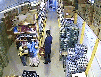Woman Steals Case of Cans by Hiding it Under Her Dress [Click to animate] Thighs of steel.