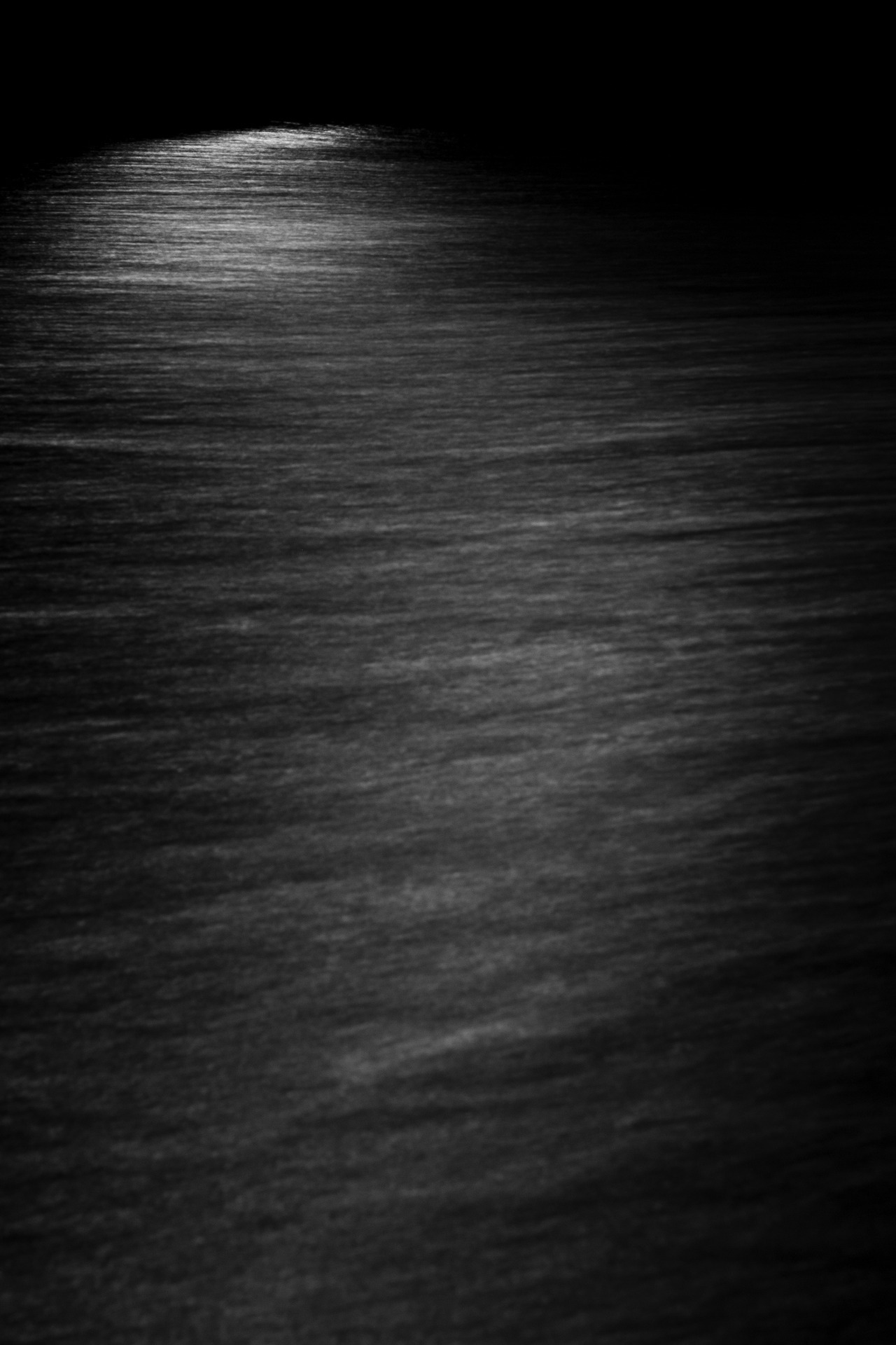 Moonlight reflected in the water- 2012  C.F.B.  When the wind blows over the water it becomes slightly agitated and these great streaks begin to form because of the moonlight. I'm going to try this more often and hopefully I can catch something in the light itself, like a person inside a boat or something. Lots of possibilities!