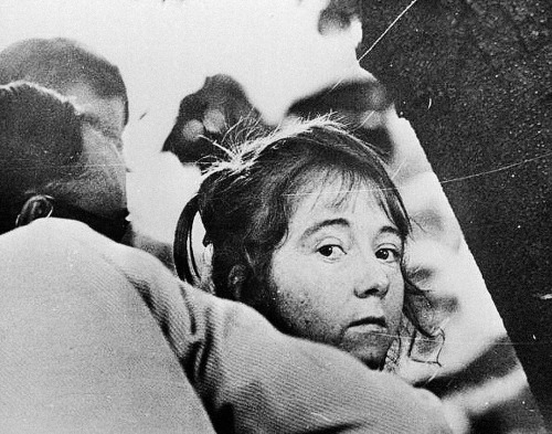 "thats-the-way-it-was:  September 5, 1975:  Sacramento, CA - an assassination attempt against President Gerald Ford is foiled when a Secret Service agent wrests a semi-automatic .45-caliber pistol from Lynette ""Squeaky"" Fromme, a follower of incarcerated cult leader Charles Manson.  Photo: ( Fromme, being led away after her failed attempt to kill President Ford) Keystone/CNP/Getty"