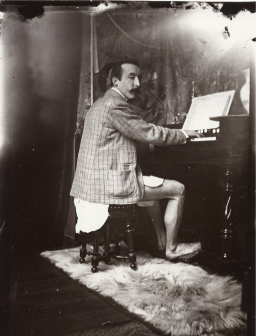 arthistoryx:  Photo of Paul Gaugin playing the harmonium with no pants. Photo by Alphonse Mucha ca. 1983Bonus: Mucha, Gauguin, & Friends cross dressing