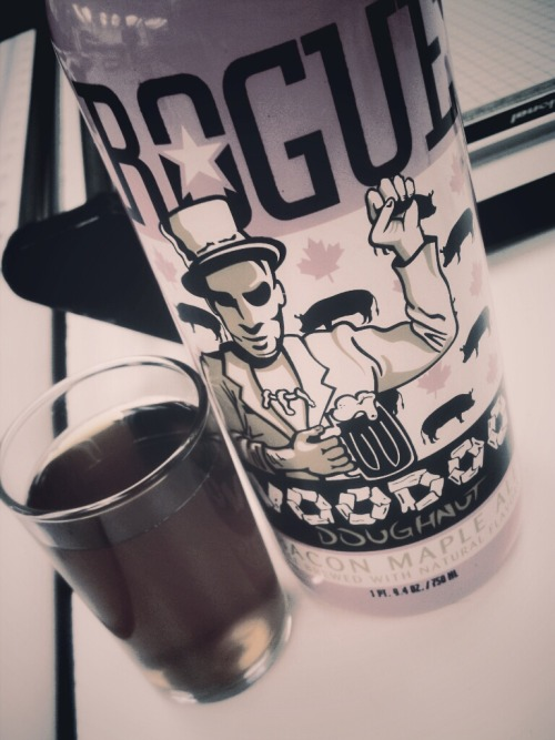 Every time I see this @RogueAles Voodoo I can't wait to open it up and taste that mapley bacony goodness. However, every time I open it I am reminded of the last time I tried it, hence why the albeit small glass in this picture is still quite full. While I admire the ingenuity and creativity of Rogue, this one is just not for me. Maple comes across well, but what I assume is the bacon taste just doesn't come across as intended. Also, where's the doughnut? That being said, I think it's one of those beers you have to try at least once. Na zdrowie!