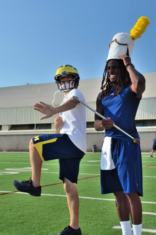 Michigan's drum major and quarterback switch places.