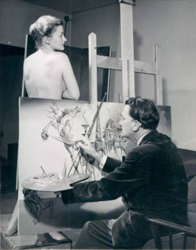 Photo of Salvador Dalí painting The Temptation of St. Anthony