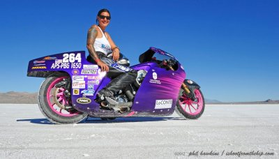 Jody Perewitz on her pink and purple partially streamlined 1650cc salt racer at the Bonneville Salt Flats. Photo by Phil Hawkins.
