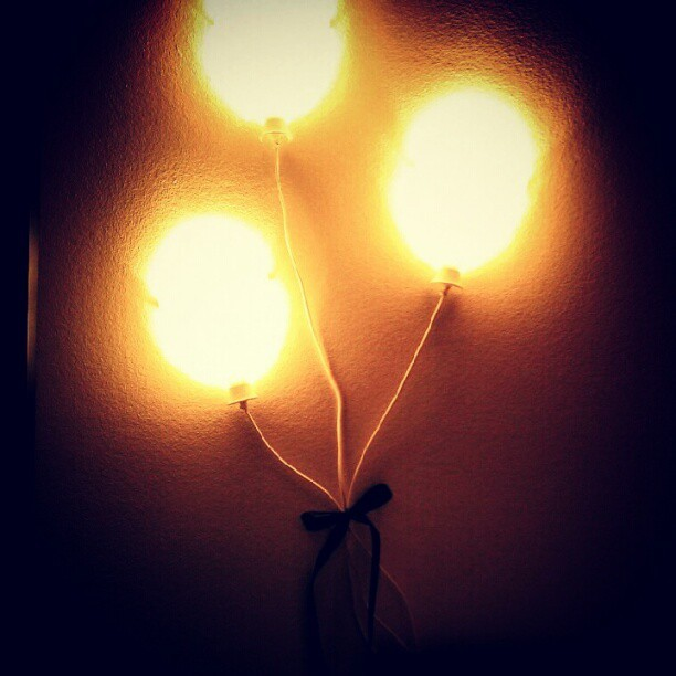 Balloons now floating by my bed. This is the most fairytale I'll ever get. (Taken with Instagram)