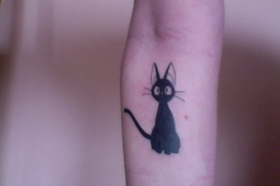 my first tattoo. this is jiji, i decided on him partly because i love the film but mostly just because i really like cats. i've always known that i wanted tattoos despite growing up in a very anti-tattoo environment. dad doesn't love it but mum drove me to the appointment.done by Sean at Coat of Arms Tattoo, Coffs Harbour.