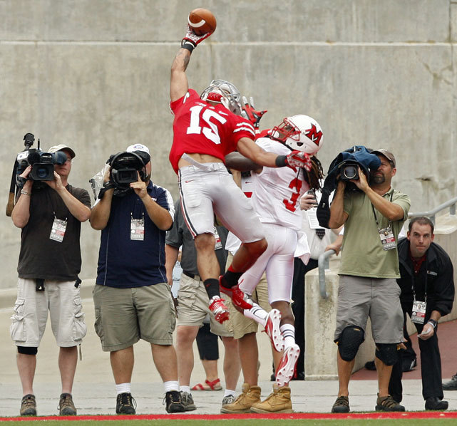 Ohio State receiver Devin Smith makes the play of the weekend with this one-handed touchdown catch against Miami (Ohio) cornerback Dayonne Nunley during the second quarter of Saturday's game. Ohio State won, 56-10. (Kyle Robertson/MCT/ZUMAPRESS.com) MANDEL: Urban Meyer wins OSU debut and other college football notesANDERSON: The best and worst of college football's opening weekendGALLERY: Top 25 review: Week 1 | The scene at Penn State