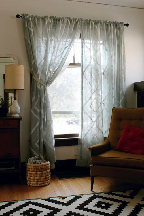 These DIY painted curtains add a handmade feel to any space. Dress up older drapes with a swipe of the ol' brush. Tutorial by Smile and Wave. - Team Forrage
