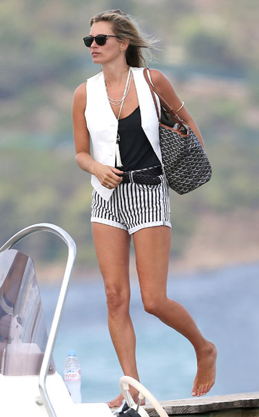 vogue:  Kate Moss in Topshop shorts and a Goyard bagVote for your favorite best dressed woman of the week on Vogue.com.See the slideshow.