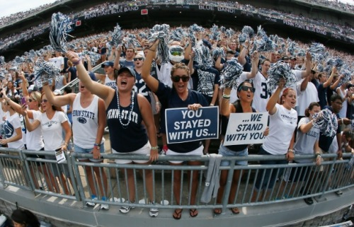 "We Are! Still! Penn State! Drew Magary went to Happy Valley to experience Penn State post-Paterno. What did he find? A lot of pissed-off people:  The only visible difference at this tailgate was the slogans. I saw so many slogans that I wished everyone at Penn State had sat down on Friday prior to gametime and settled on just one. But they didn't, and this was the resulting word soup: ""Penn State Forever"" ""Joe Knows Football"" ""We Are"" ""We Care"" ""Those who stayed may not be champions, but they will forever be legends."" (I thought this one was the stupidest of the bunch.) ""Roll up your pant legs. This is JoePa's house."" ""Still Proud"" ""Success with honor"" ""Coach Paterno, only one thing: Thank you!"" ""NCAA"" (with a hammer & sickle replacing the C) ""Restore the roar"" ""Hey media… we know the truth"" (Somehow I doubt that Bobby from Delta Upsilon knew more about the Sandusky case than Sara Ganim) ""O'Brien's Lions"" ""We Are… Pissed Off"" (It's worth noting that no one who rocked this slogan looked all that pissed off) ""More than a man, more than a coach, you touched our soul"" ""One Team"" ""Those people"" (???) ""Billieve"" (referring to PSU head coach Bill O'Brien) ""We are… because he was"""