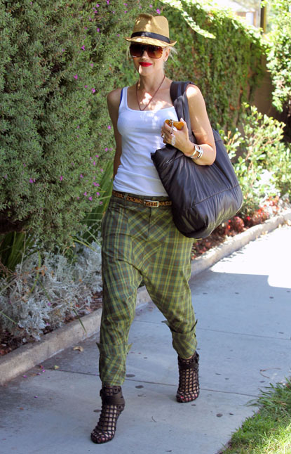 A stylin' Gwen Stefani wears green flannel harem pants and black cutout heel ankle boots on her way to get a mani-pedi at a Beverly Hills nail salon on September 1, 2012.