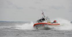 A crew aboard a new 45-foot Response Boat – Medium from Coast Guard Station Cape Charles, Va., conducts tactical turn training in the Chesapeake Bay, Friday, Aug. 24, 2012. The station's RB-M is the 100th boat of 166 being delivered to the Coast Guard to replace the aging 41-foot Utility Boat fleet. U.S. Coast Guard photo by Petty Officer 3rd Class David Weydert