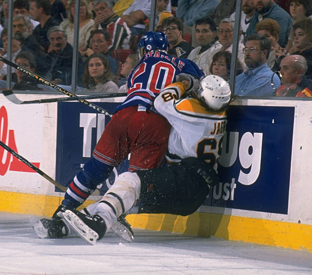 Luc Robitaille pounds Jaromir Jagr into the boards during a 1996 Rangers-Penguins game. (David E. Klutho/SI) GALLERY: Jaromir Jagr at 40