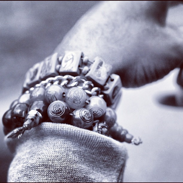 A nice photograph by @rhysentlycorbetto of my Buddhist beads. #photography #photograph #stilllife #bw #black #blackandwhite #bandw #white #grey #buddhist #beads #bracelets #accessories #wrist #hand  (Taken with Instagram)