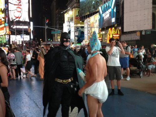 """Walking Home"" — ""New York batman meets a naked baby."" Umm, the opposite of a dull evening? #funfriday Thanks to Kristen H. Try our app, get your photo shared!"