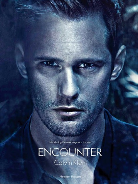 "Alexander Skarsgard has been the cause of numerous heart palpitations and emergency room visits all across the world. The audiences who know Alex as Eric Northman on True Blood, have been as dedicated to him as one would be dedicated to one's ex if one were psychotic. Alex's face has caused a massive baby boom, with women falling pregnant at the sight of his chiseled features. What would be the Holy Grail of Alex fans? A picture of him in white briefs? A sex video? What would make fans die in front of their computers and re-post the Holy Grail to all of their Facebook friends? We have the answer – A Calvin Klein advertisement. No, before small moans of madness escape your mouth, the man will not be dressed in white briefs made from the hair of a unicorn. In this latest advertisement for CK, Alex's face receives all of the glory. He is presented in an icy, palpable and semi-stoic facial pose, with every line on his skin magnified and over produced. We have heard rumours of women (and men) looking at these images and muttering, ""It's like staring into the face of God…"""