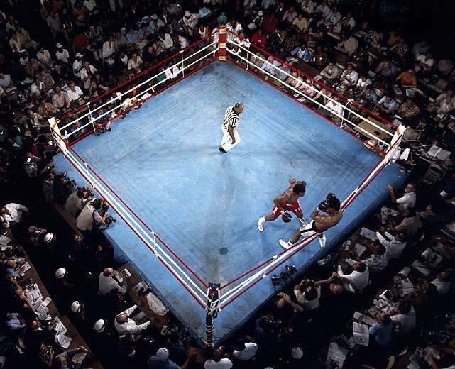 siphotos:  Muhammad Ali and George Foreman battle against the ropes during their Oct. 1974 fight in Zaire. Ali won after knocking out Foreman in the eighth round.