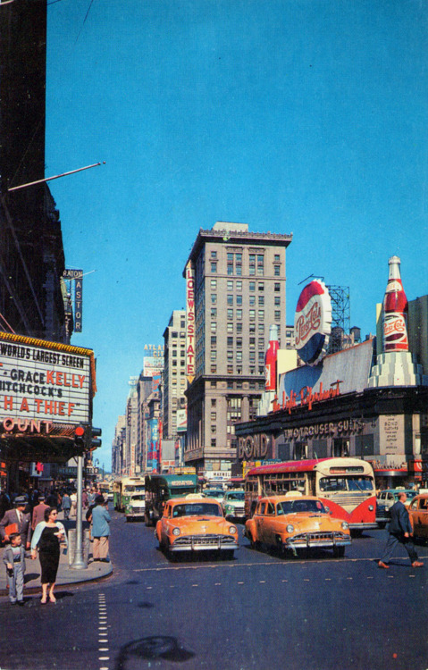 ghostofyesterday:  timetravelnow:  1950s, Times Square New York City  Ah, to have lived in a time when the latest Hitch was on the big screen.