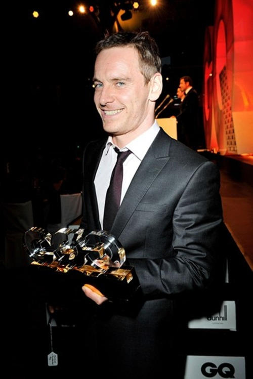"GQ ACTOR OF THE YEAR, MICHAEL FASSBENDER, AT THE GQ MEN OF THE YEAR AWARDS When George Clooney name-drops you at the Golden Globes, you know it's been a very good year. For Michael Fassbender, GQ's Actor Of The Year, the last 12 months have seen a run of form which most leading men can only dream of. His 2012 began in British cinemas with Steve McQueen's stunning sex addiction drama Shame, followed by Steven Soderbergh's frenetic thriller Haywireand David Cronenberg's disturbing A Dangerous Methodbefore concluding, in some style, as chilling blonde android David in Ridley Scott's sci-fi epic Prometheus.  Fassbender straddles art house and blockbuster alike and the 35-year-old's work has seen him embraced by Hollywood's finest, from Sir Ridley (who has already signed the actor for his next project, The Counselor) to Brad Pitt, who will co-star in McQueen's next film Twelve Years A Slave. Fassbender even graced his first GQ cover in February, telling Olivia Cole that part of his strength was recognising his vulnerability: ""I'm not immune to anything but I'm aware of my weakness and the beast within"". Question is, how does one follow a run of four superb cinematic performances? Well, with GQ's Actor Of The Year award, to start… GQ"