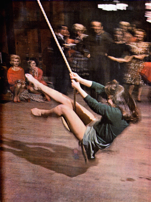 timetravelnow:  1963, Girl at party uses rope swing