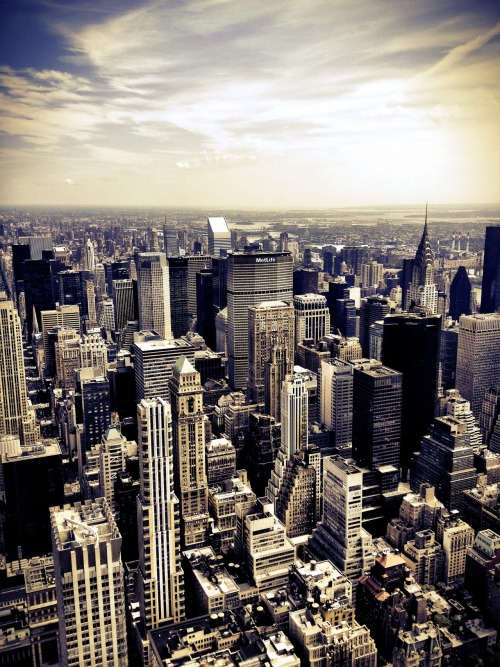"nythroughthelens:  The Chrysler Building and New York City skyline as seen from the Empire State Building. Looking out over New York City from up high, the skyscrapers rise from the ground proudly as if they are marching towards the horizon where the city and the sky meet briefly and where steel dissolves into light. —- This photo was taken with my phone and edited with Camera +. I am @newyorklens on Instagram (view my feed here). Check out my other phone photography posts made to this blog here. You can check out all of my mobile photography photos on Flickr here. Additionally, you can view my phone photography for sale here. —- View this photo larger and on black on my Google Plus page —- Buy ""The Chrysler Building and Skyscrapers of New York City"" Prints here, My mobile photography for sale here, My regular photography for sale here, email me, or ask for help.  This Fall."