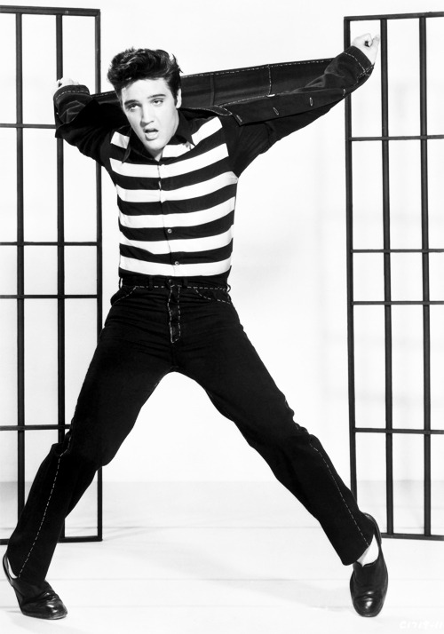 marthaivers:  1957: American actor and singer Elvis Presley dancing in a stylized prison uniform, in a promotional portrait for director Richard Thorpe's film, 'Jailhouse Rock.