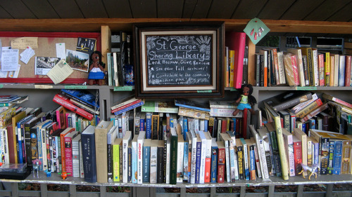 "Around Town: 'The St. George Sharing Library' I was biking along the 10th Ave bikeway the other day and noticed this neat lil library hanging on the fence in front of a house. So I stopped and snapped a picture of it. The ironic thing was when I went online later in the day I turned up an article looking at community based pop up libraries here in Vancouver! It even had a section covering this one. Here's an excerpt:  ""The two-tiered structure on East 10th Avenue, near St. George Street, was assembled by George Rahi and his roommates. Previously an old shelf found discarded in an alley, it is now stacked with dozens of books, free for the taking – a little library made by, and for, the community. Recent offerings include textbooks, novels and children's books; a notice board is covered in hand-written thank-you notes. (""I have found quite a few little gems at your library hot-spot, and for this, I am grateful,"" reads one.)"" (Source: Globe & Mail)  I've got more photos here if you're interested. Related: 'How to Create a Pop-Up Library' (Shareable) 'From Clothing Swaps to Tool Libraries, Sharing is Not Rocket Science' (Treehugger)"