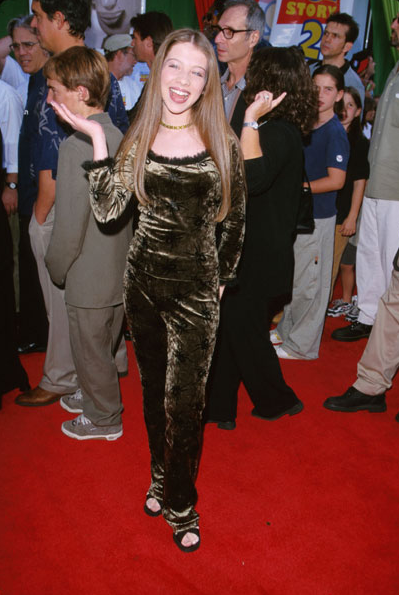 Michelle Trachtenberg in a slightly inappropriate bodysuit at the 1999 premiere of Toy Story 2.