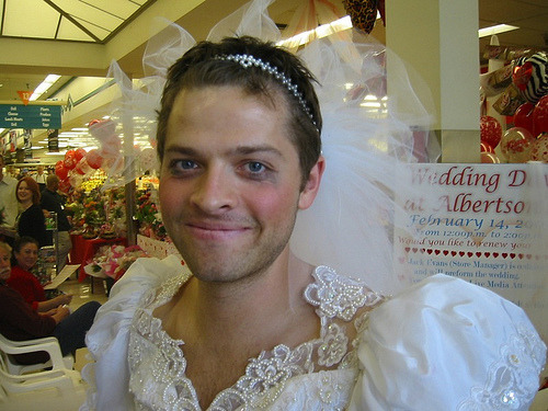 karmannghiaburana:  strangepicturesofmishacollins:  chuckandblairfeels submitted:  i found it on the interwebs, i have no idea whos it is or whether you have it or not. but it is strange, in the best way possible.  Ah, yes. Misha and Vicki renewed their vows at Albertsons.  The bride looked radiant in his gown, while the groom wore a white tuxedo with a pink ruffled shirt and a pink pearled hat to accent. A phallic vegetable bouquet was her accessory.  The best man:  The sock monkey:  The ceremony was beautiful. Everyone cried.     Surprise twist ending: Misha and Vicki are beautiful.   If they aren't a prefect couple I don't know what is.