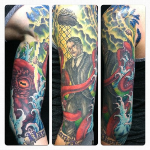 fuckyeahtattoos:  Tesla v. Kraken, done by the AMAZINGLY TALENTED Perry Stratton at Splash of Color in East Lansing, Michigan.  THE FINEST TATTOO I HAVE EVER SEEN OH GOD YES COVER MY BODY WITH THIS