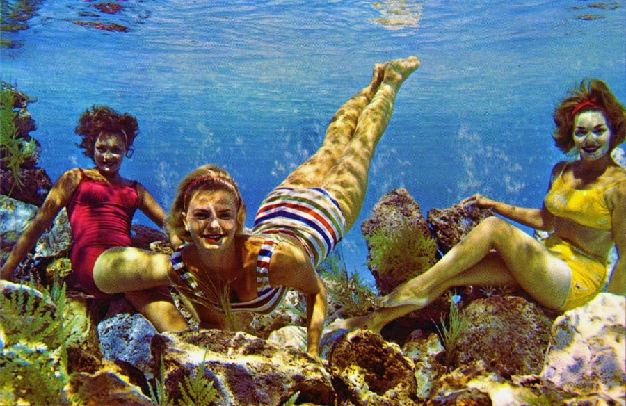 Mermaids on the rocks at Cypress Gardens, Florida 1960s