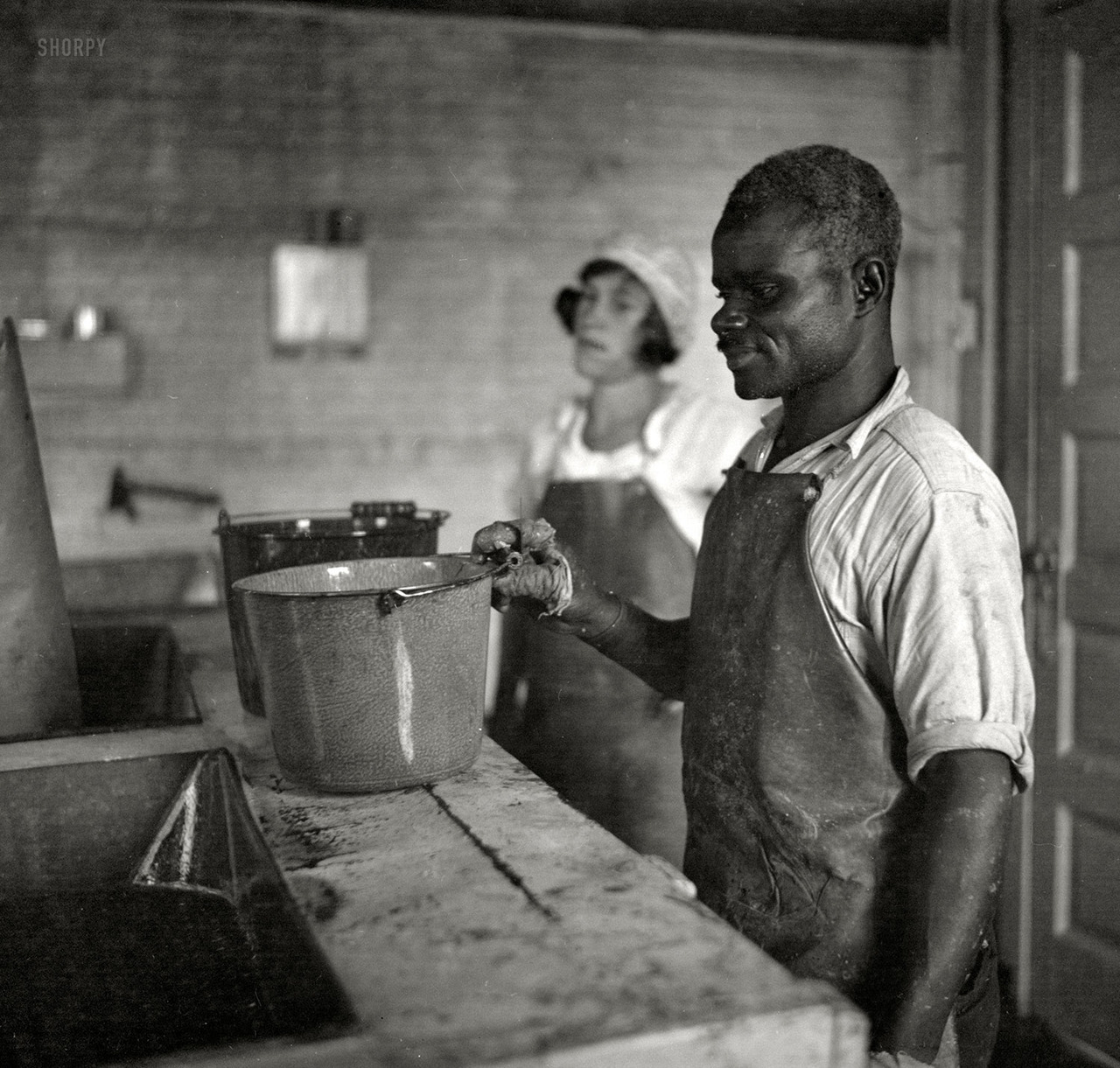 Washing oysters. Maryland, 1936. By Arthur Rostein